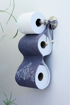 Such a clever idea!  2roll toilet paper holder modern Jacobean hand by vijako on Etsy. $45.00, via Etsy.