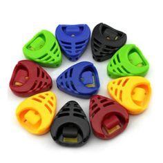 Description: Fashionable and easy to carry. Solid and durable. Fit for all guitars. Material: Plastic Colour:White, Blue, Green, Red, Black, Yellow (Color will be sent at random) Keeps Picks Accessible During Performance. Adhesive back, there is one piece of glue paper on the back of the...