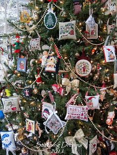 Cross Stitch Ornaments on the Christmas Tree.....Looks like a lot of my moms that she cross stitched  :)  Love them