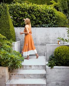 """Outdoor spaces are all about ease of use. If there are any barriers, one is unlikely to use the space—which is the worst case scenario,"" says fashion stylist @lauren_michael_goodman, pictured here at her San Francisco home. She collaborated with architect @jenniferweissarchitecture on the garden's hardscape and @terremoto_landscape on the planting design. ""The concrete stairs were designed to make the second level inviting, and the process of getting there luxurious, beautiful, and easy,""…"