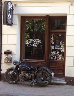 Motorcycle in front of tattoo store