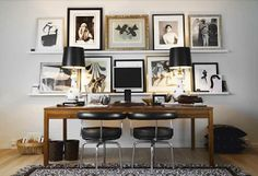 Love the graphic quality of all the black & white mixed with some metallic. Love the two lamps with the glossy black shades. Love the large size of the frames, that they're all different & that the subject matter within is different.