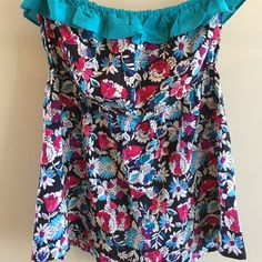 ⭐️FLORAL strapless top. Like new. so cute! Small⭐️ This is a strapless in the cutest colors of turquoise, rose, cream and black. Has elastic around top and waist and hangs loose down from waist. Not a crop top. Will hang over waist of shorts or jeans even if they are low rise. Ruffle detail at top. Size small. Urban Outfitters Tops