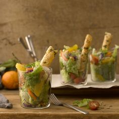 Cup Salads with Parmesan Straws - Talk about a showstopper.  Elegant straws of savory Parmesan tower over colorful cups of crunchy romaine, cherry tomatoes, hearty white mushrooms and sweet, juicy oranges in this no-fuss, all-glamour salad that'll be sure to shine as your opening act.