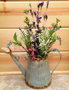 artificial flower arrangements in tin watering can - Google Search