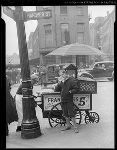 Enjoying a hotdog stand in North End of Boston (1937).