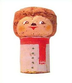 Painted cork people from champagne corks.