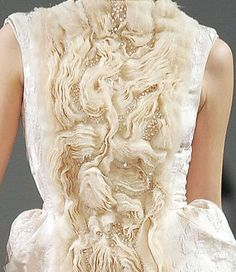 Fabric manipulation for fashion - ivory dress with beautifully sculpted tonal textures; wearable art