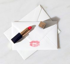 Write him a romantic love letter 💌 and add a kiss on the back of it. Makeup Photography, Flat Lay Photography, Estee Lauder, Beauty Routines, Lip Colors, Landscape Sketch, Lipstick, Sketches, Abstract