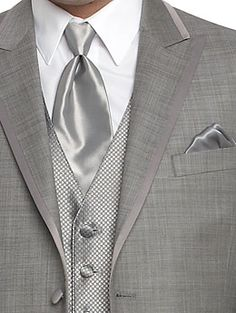 Are you obesessed with the idea of your groom standing out? Put him in a gray tuxedo from Louie's instead!