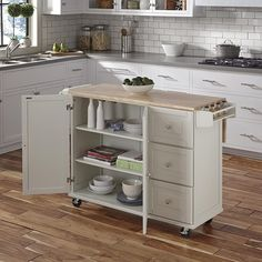 Discover the top-rated farmhouse style kitchen island carts and farmhouse bar carts on wheels. We have a huge selection whether you need a kitchen island on wheels for your farmhouse kitchen or a farmhouse rolling bar cart with a tray on top. White Kitchen Cart, Kitchen Island Cart, Rustic Kitchen, New Kitchen, Kitchen Decor, Kitchen Cabinets, Kitchen Carts On Wheels, Portable Kitchen Island, Kitchen Island For Small Kitchen