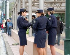 A gaggle of Greek policewomen get ready to marshall the crowds at the March 25 National Day Parade. Police Uniforms, Girls Uniforms, Tie Up Stories, Female Police Officers, Short Person, Professional Wear, Military Women, Armed Forces, Wonder Woman