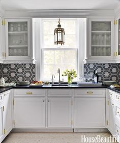 An antique lantern becomes a focal point in the butler's pantry. Backsplash, Tile Showcase.