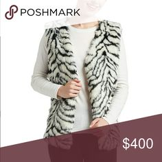 COMING SOON!!! Zebra printed faux fur vest Take a walk on the wild side with this bold zebra printed faux fur plush texture vest.  M is 28in. Long from shoulder to hem. 100% polyester Chupchick  Jackets & Coats Vests