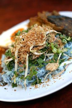 nasi kerabu : blue coloured rice served with coconut salad and a special sause For more detail, please visit http://www.cookmalaysianfood.com