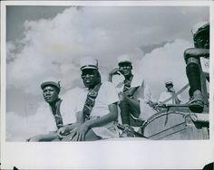 Wakamba Members of Kenya Native`Police Reserve watch their Triblesfolk perform a dance. Mau Mau period. C.1950s