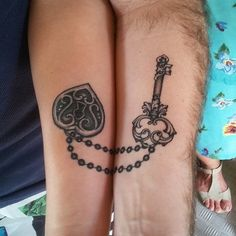 A wonderful looking complimentary couple tattoo. The chain that connects the heart pendant and the key is shown to be connected when both the partners are together. This shows that they can only be complete when they are with each other.