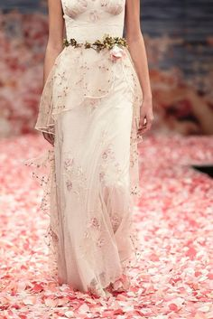 From the Earthly Paradise Couture Bridal CollectionPromise is a Sleeveless V-neckline bridal gown with pink rose embroidery on dotted Swiss tulle sheath. The...