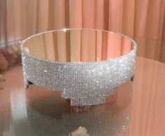 My girl NitraaB bought this for her wedding! It is absolutely beautiful and blingy!! Crystal Cake Stand  16 round with mirror top by POSHWeddingDecor, $350.00