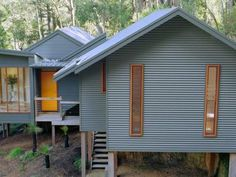 Colorbond wall cladding is a low cost, durable material which suits a range of house designs House Cladding, House Siding, Facade House, Wall Cladding, Metal Building Homes, Metal Homes, Building A House, Shed Homes, Prefab Homes