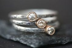$150  Simple, modern and organic.    These stunning, round-cut 3mm (.10kt) Champagne Diamonds rest in a rich 14kt gold bezel, with the contrast of a hammered, oxidized sterling silver band.