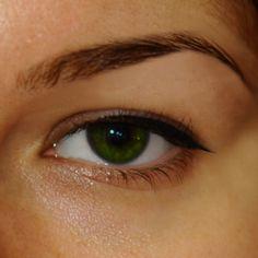 makeup for hooded eyes - apply eyeliner looking  straight ahead