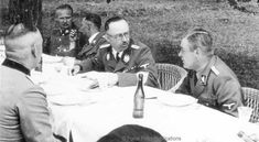 Heinrich Himmler, center, visiting Lublin and conferring with SS Gruppenführer Odilo Globocnik
