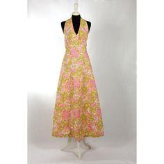 Atmosfera degli anni '70 nei colori e nel tessuto di quest'abito originale vintage.