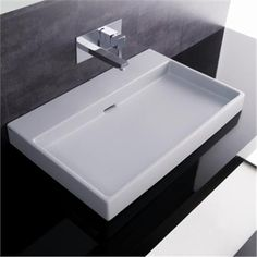 Italian design ... elegance, flexibility and a sleek, concealed drain. This white, rectangular, Italian ceramic washbasin can be wall-mounted or countertop mounted. Also comes in two versions - with a faucet hole for a deck mounted faucet, or without a faucet hole for a wall mounted faucet. Built in overflow. } Urban 70 Italian Ceramic Sink, on www.SinksGallery.com