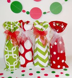 The Office Christmas Party will never be the same. Decorate a corner table with festive wine bags and matching banner and confetti.  Perfect