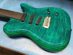 Kiesel Guitars Carvin Guitars Such a rad Deep Teal Flame on this TL60T.