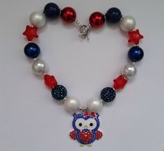 This adorable owl necklace is perfect for any patriot or for the 4th of July! Features 18, 20mm beads and a sweet red, white, and blue owl pendant.  This ready to ship necklace measures approximately 17 inches but can be customized or extended if necessary. Simply message me and I will create a custom listing. **Please note that this necklace is composed of small pieces that can pose a choking hazard. Please supervise children during wear.**