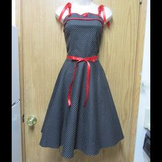 Divine Black Rockabilly Dress W/White Polka Dot This dress is really cute and incredible!!! Unique design. Gorgeous colors and exquisite decoration. Belt included. Size Small - Almost New - Save $$$ on bundles Dresses Midi
