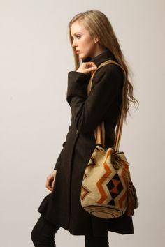Wayuu Mochila bag handmade by the indigenous  women of South America's La Guajira region.  www.wayuutribe.com $75.00 and up.