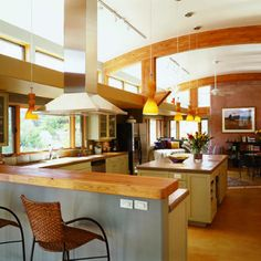 If you have the ceiling height, clerestory windows allow so much light without giving up privacy.  Big curved beams create a wide-open kitchen/family room. Clerestory windows bounce the light off the ceiling, brightening the space.  Solar house in Prescott, Arizona