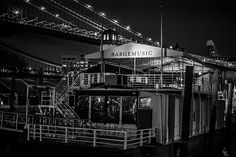 Bargemusic, Brooklyn, New York City. New York City's floating concert hall I love this floating barge / building. The lighting in the area has a cool feel to it. I love Brooklyn at night. Just another piece of Brooklyn you may not have known about. Enjoy. Moored in Brooklyn just under the Brooklyn Bridge, Bargemusic presents great music up to five days a week, every week of the year.