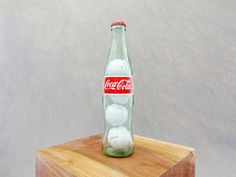 Put some golf balls inside a Coke bottle!This is a conversation piece that I made just for fun. It would make a great gift for the Coca-Cola and/or golf lover in. Coca Cola, Golfball, Wood Projects, Projects To Try, Woodworking Projects, Golf Ball Crafts, Bois Diy, Golf Gifts, Wood Working For Beginners