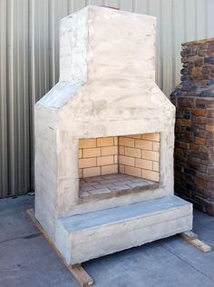 Our outdoor fireplaces can easily be finished to match any home or building exterior. They also come pre-assembled and ready-to-finish. Discover more by calling Round Grove Products at outdoor fireplace Outdoor Fireplace Outdoor Fireplace Brick, Brick Oven Outdoor, Outdoor Fireplace Designs, Backyard Fireplace, Diy Outdoor Kitchen, Outdoor Rooms, Backyard Patio, Outdoor Fireplaces, Outdoor Kitchens