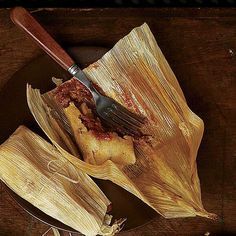 There are different styles of tamales throughout Latin America, but their essential components—masa, a filling, and a wrapper—are the same. Wrapped in corn husks and served with a smoky chile sauce, these are traditionally Mexican.