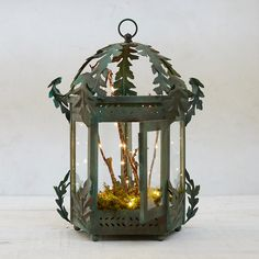 """Terrain Intricately framed in oak leaves and topped with an acorn finial, this iron lantern is hand-crafted and finished with a verdigris tint for antique appeal.- Iron, glass- Wipe clean with damp cloth- Indoor use only- Imported15""""H, 6"""" diameter"""