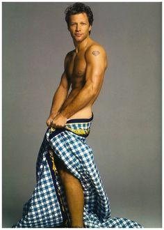John Bon Jovi .. Will someone please throw this man a guitar :)!!!