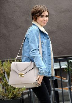 Lily Collins wears The Chicago handbag by Milli Millu ($689) http://www.millimillu.com/shoulder-bags/the-chicago-taupe.html