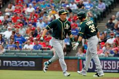 Healy's homer:   Ryon Healy is congratulated by Oakland A's teammate Brett Eibner after hitting a solo home run against the Texas Rangers on Aug. 15 in Arlington, Texas.