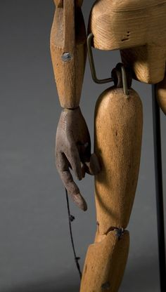 Marionettes image 5 _ooo, a puppet from this detail angle, strings in 1 hand & a scissors in the other...