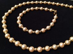 This ivory glass pearl and gold necklace and bracelet set add a little class to an outfit. I wear them often. ~JET