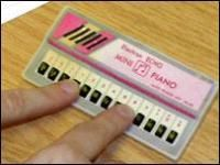 Mini piano. I remember this being a craze for a short time, and then they disappeared just as quickly as they had appeared. Go fig.