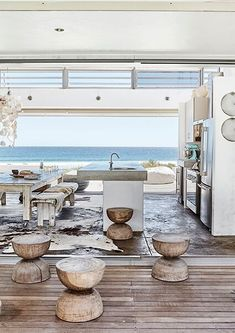 Amazing beach house kitchen opens up to the shore Beach Cottage Style, Beach Cottage Decor, Coastal Cottage, Coastal Style, White Beach Houses, Dream Beach Houses, Beach House Kitchens, Home Kitchens, Villa
