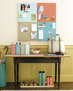 Colour-coded bulletin board (one coloured square per family member); matching colour containers for each person's mail