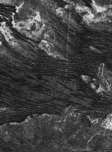 Lines of dunes crawl across the surface of Titan, Saturn's largest moon, in a radar image showing dunes as dark. Experiments at ASU's wind tunnel indicate the dune particles move only under winds that blow stronger than scientists previously thought. Photo by: NASA/JPL-Caltech/ASI #space #planet #saturn #moon #titan