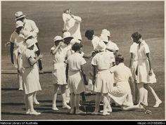 English women's cricket team taking a drinking break on the field, 1934-35